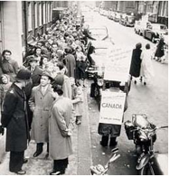 Crowds queue up outside the Canadian government Immigration office in London, England, during the 1956 immigration rush.